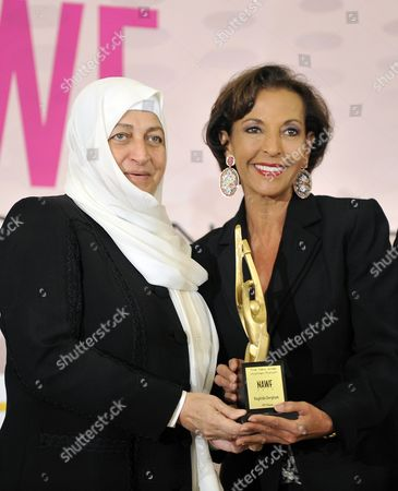 Stock Photo of Lebanese Mp Bahia Hariri (l) Honours Raghida Dergham (r) Senior Diplomatic Correspondent of Al Hayat Usa During the Opening of the Fourth Round For New Arab Woman Forum (nawf) in Beirut Lebanon 02 December 2010 the Annual Conference Runs For Two Days on 02 and 03 December 2010 Lebanon Beirut