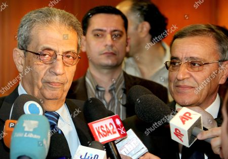 Lebanese Foreign Minister Ali El Shami (r) and the Secretary General of the Arab League Amr Moussa (l) Addresses the Media at Rafiq Hariri International Airport in Beirut Lebanon 17 March 2010 Lebanese President Michel Suleiman and Prime Minister Saad Al-hariri Had Reject a Call by Libyan's President Mouaamar Gaddafi Sent to Lebanon Through the Lebanese Embassy in Damascus to Attend Arab Summit Lebanese President Michel Sleiman Will not Attend an Arab League Summit in Tripoli Due to a Row Over the Disappearance of Prominent Shia Cleric Mussa Al-sadr in Libya in 1978 Imam Mussa Al-sadr the Founder of the Amal Movement Went Missing with Two of His Companions Mohammed Yaqoub and Abbas Badreddin While on an Official Visit to Libya in August 1978 Lebanon Beirut