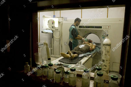 A Man with a Bullet Wound in His Head Goes Through a Scanner Section at the Misrata Hospital in Misrata Libya on 12 April 2011 Media Reports State That Libyas Rebel-run Interim Transitional National Council (itnc) Said on 12 April 2100 the the Muammar Gaddafi Regime was 'Accelerating Attacks on Misurata' and Warned He May Be Planning a 'Potentially Devastating Attack' on the Besieged Town in the Coming Hours According to Intc Spokesman Abdul Hafiz Ghoga Gaddafi Loyalists Are Using Grad Missiles to Target the Western Town of 500 000 Which Remains in Rebel Hands Libyan Arab Jamahiriya Misrata