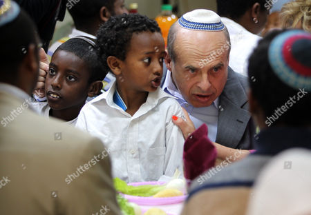 Natan Sharansky the Chhairman of the Executive of Israel's Jewish Agency Since 2009 Sits with Recent Immigrants From Ethiopia Waiting For a Rehearsal of a Passover 'Seder' Meal to Begin in the Absorption Center in Mevesseret Zion Outside Jerusalem on 14 April 2011 the Meal was Organized by the Jewish Agency in Order to Teach the Recent Jewish Immigrants About the Jewish High Holiday That Commemorates the Israelites Exodus From Ancient Egypt Passover is Celebrated For Eight Days Beginning with the Seder on Monday April 18 at Sun Down Sharansky Born in 1948 was the First Political Prisoner Released From the Soviet Union by Mikhail Gorbachev and Emigrated to Israel where He was Elected to the Knesset (parliament) and Served in Two Ministerial Posts in Prime Minister Ariel Sharon's Government Israel Mevesseret Zion