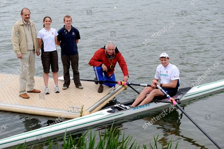 Alan Campbell, the GB single sculler with his coach Bill Barry (red coat), Valeri Klesnev (in light jacket) the chief Biomechanic, Gill Edmondson (crouching) the physiotherapist, and physiologist Mark Homer (dark blue shirt).