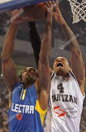 Alan Anderson (l) of Maccabi Electra in Action Against Lawrence Roberts (r) of Partizan Belgrade During Their Euroleague Quarterfinal Basketball Match in Belgrade Serbia 01 April 2010 Serbia Belgrade