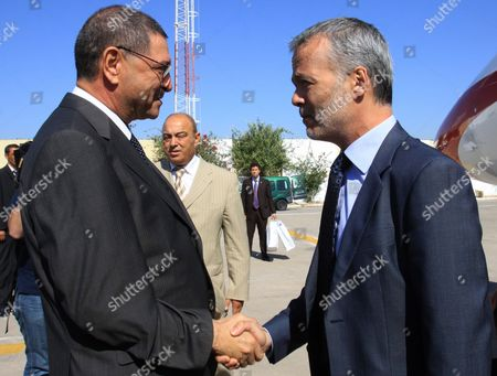 Tunisian Interior Minister Habib Essid (l) Greets His Spanish Counterpart Antonio Camacho (r) Upon His Arrival in Tunis on 27 July 2011 Camacho was Appointed on 11 July As New Spain Interior Minister Tunisia Tunis