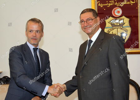 Tunisian Interior Minister Habib Essid (r) Shakes Hands with His Spanish Counterpart Antonio Camacho (r) Upon His Arrival in Tunis on 27 July 2011 Camacho was Appointed on 11 July As New Spain Interior Minister Tunisia Tunis