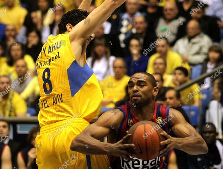 Lior Eliyahu of Maccabi Electra Tel Aviv (l) Fights For the Ball with Alan Anderson of Fc Barcelona During Their Euroleague Top 16 Match at Sinan Erdem Arena in Istanbul Turkey on 24 February 2011 Turkey Istanbul