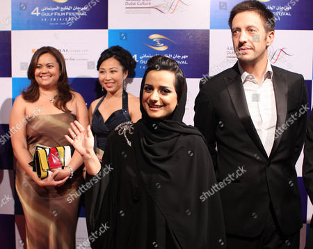 Uae Film Producer Nayla Al Khaja (c) Waves As She Arrives on the Red Carpet During the Opening the 4th Gulf Film Festival 2011 in Gulf Emirate of Dubai United Arab Emirates 14 April 2011 United Arab Emirates Dubai