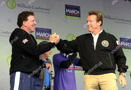 Stock Picture of California Governor Arnold Schwarzenegger (r) and Actor and Fitness Personality Jake Steinfeld (l) Grasp Hands During the March on Alzheimer's Event in Long Beach California Usa 24 October 2010 Over 1 000 People Marched in Support of Finding a Cure For the Debilitating Degenerative Neurological Disease That Affects Millions of People Worldwide the Event is Part of the 3-day Women's Conference Which Brings Together World Opinion Leaders and is the Premier Forum For Women in the United States United States Long Beach