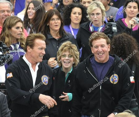 Stock Photo of California Governor Arnold Schwarzenegger (l) Actress Jane Fonda (c) and Actor and Fitness Personality Jake Steinfeld (r) and Other Celebrities Lead the March on Alzheimer's Event in Long Beach California Usa 24 October 2010 Over 1 000 People Marched in Support of Finding a Cure For the Debilitating Degenerative Neurological Disease That Affects Millions of People Worldwide the Event is Part of the 3-day Women's Conference Which Brings Together World Opinion Leaders and is the Premier Forum For Women in the United States United States Long Beach