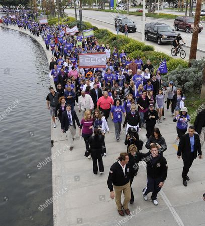 Stock Image of California Governor Arnold Schwarzenegger (l) Actress Jane Fonda (c) and Exercise Guru Jake Steinfeld (r) Lead the March on Alzheimer's Participants in Long Beach California Usa 24 October 2010 Over 1 000 People Marched in Support of Finding a Cure For the Debilitating Degenerative Neurological Disease That Affects Millions of People Worldwide the Event is Part of the 3-day Women's Conference Which Brings Together World Opinion Leaders and is the Premier Forum For Women in the United States Epa/mike Nelson United States Long Beach
