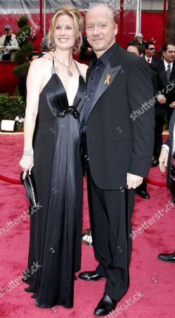 Canadian Actor Paul Haggis (r) and Wife Us Actress Deborah Rennard (l) Arrive For the 80th Annual Academy Awards at the Kodak Theatre in Hollywood California Usa 24 February 2008 the Academy Awards Popularly Known As the Oscars Are Presented by the Academy of Motion Picture Arts and Sciences (ampas) to Recognize Excellence of Professionals in the Film Industry Including Directors Actors and Writers
