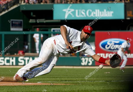 St Louis Cardinals' Albert Pujols Makes a Diving Stop on a Ball Hit by Los Angeles Dodgers' Garret Anderson (not Pictured) at Busch Stadium in St Louis Missouri Usa on 17 July 2010 United States St. Louis