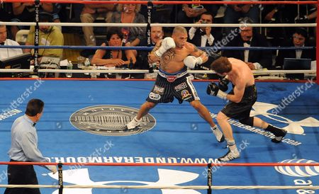 Miguel Cotto of Puerto Rico (l) Hits Yuri Foreman of the United States During the Wba World Super Welterweight Title Fight at Yankees Stadium in the Bronx New York Usa on 05 June 2010 United States Bronx