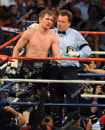 Yuri Foreman of the United States is Led Away by Referee Arthur Mckinney Jr After a Ninth Round Tko by Miguel Cotto of Puerto Rico During the Wba World Super Welterweight Title Fight at Yankees Stadium in the Bronx New York Usa on 05 June 2010 United States Bronx