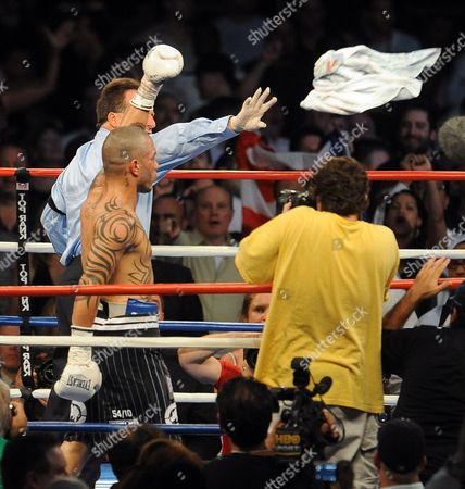 Miguel Cotto of Puerto Rico (2l) Reacts As Referee Arthur Mckinney Jr (l) Discards a Towel That was Inappropriately Thrown Into the Ring During the Seventh Round Against Yuri Foreman of the United States During the Wba World Super Welterweight Title Fight at Yankees Stadium in the Bronx New York Usa on 05 June 2010 the Fight Continued and Ended in a Ninth Round Tko by Miguel Cotto United States Bronx