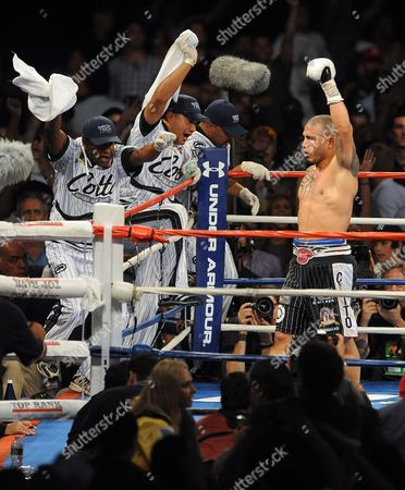 Miguel Cotto of Puerto Rico (r) Reacts After a Towel That was Inappropriately Thrown Into the Ring During the Seventh Round Against Yuri Foreman of the United States During the Wba World Super Welterweight Title Fight at Yankees Stadium in the Bronx New York Usa on 05 June 2010 the Fight Continued and Ended in a Ninth Round Tko by Miguel Cotto United States New York