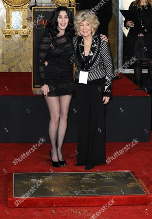 Us Actress/singer Cher (l) Poses with Her Mother Georgia Holt (r) After Putting Her Hand and Footprints in Cement During Ceremony at Grauman's Chinese Theatre in Hollywood California Usa 18 November 2010 Academy Award Golden Globe and Emmy Award Winner Cher is Currently Starring in the Film 'Burlesque' United States Los Angeles