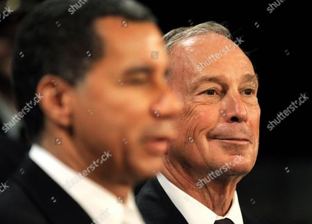 New York City Mayor Michael Bloomberg (r) Listens to New York Governor David Patterson (l) During a Press Conference About the Expansion and Improvements of One of the Terminals at John F Kennedy International Airport at City Hall in New York New York Usa on 11 August 2010 United States New York
