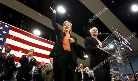 Us Senator and Democratic Presidential Hopeful Hillary Clinton (l) Waves to the Crowd Along with General Wesley Clark (r) at a Rally in Waco Texas Usa 29 February 2008 the Texas Primary is 04 March 2008
