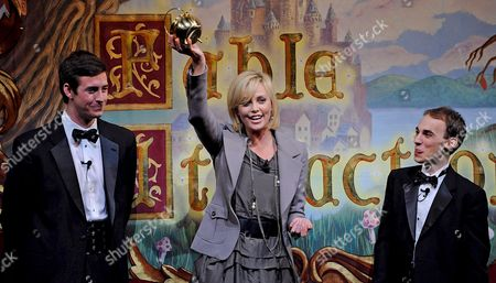 South African Actress Charlize Theron (c) with David Anderson (l) and Evan Eachus (r) of the Hasty Pudding Theatricals Holds Her Pudding Pot Aloft Following the Roast Portion of the Presentation of the 2008 Hasty Pudding Theatricals Woman of the Year at the New College Theatre On the Harvard University Campus in Cambridge Massachusetts Usa 7 February 2008 the Woman of the Year Award is Presented Annually to a Performer Who Has Made a 'Lasting and Impressive Contribution to the World of Entertainment ' and Theron Joins Other Past Honorees Including Meryl Streep Katharine Hepburn Julia Roberts Jodie Foster Meg Ryan Halle Berry and Most Recently Scarlett Johansson