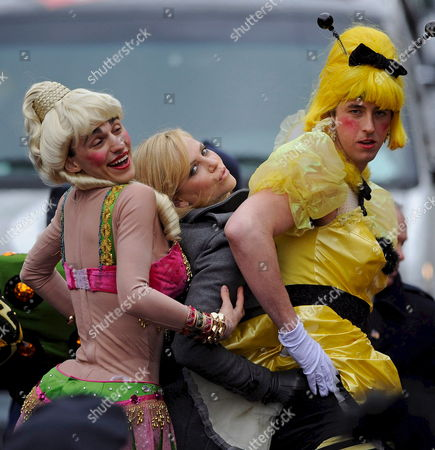 South African Actress Charlize Theron (c) Along with David Anderson (l) and Evan Eachus (r) of the Haxty Pudding Theatricals Pose For Photographers During the Parade Portion of the Presentation of the 2008 Hasty Pudding Theatricals Woman of the Year at the New College Theatre On the Harvard University Campus in Cambridge Massachusetts Usa 7 February 2008 the Woman of the Year Award is Presented Annually to a Performer Who Has Made a 'Lasting and Impressive Contribution to the World of Entertainment ' and Theron Joins Other Past Honorees Including Meryl Streep Katharine Hepburn Julia Roberts Jodie Foster Meg Ryan Halle Berry and Most Recently Scarlett Johansson