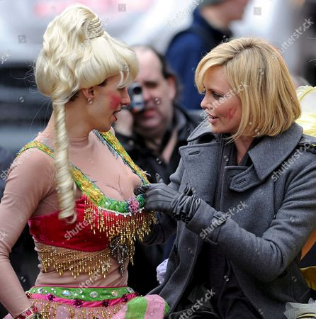 South African Actress Charlize Theron (r) Pokes the Fake Breasts of David Anderson (l) of the Haxty Pudding Theatricals During the Parade Portion of the Presentation of the 2008 Hasty Pudding Theatricals Woman of the Year at the New College Theatre On the Harvard University Campus in Cambridge Massachusetts Usa 7 February 2008 the Woman of the Year Award is Presented Annually to a Performer Who Has Made a 'Lasting and Impressive Contribution to the World of Entertainment ' and Theron Joins Other Past Honorees Including Meryl Streep Katharine Hepburn Julia Roberts Jodie Foster Meg Ryan Halle Berry and Most Recently Scarlett Johansson