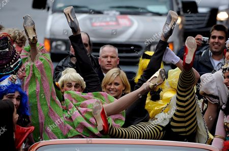 South African Actress Charlize Theron (c) Along with David Anderson (l) and Evan Eachus (r) of the Haxty Pudding Theatricals Show Off Their Legs During the Parade Portion of the Presentation of the 2008 Hasty Pudding Theatricals Woman of the Year at the New College Theatre On the Harvard University Campus in Cambridge Massachusetts Usa 7 February 2008 the Woman of the Year Award is Presented Annually to a Performer Who Has Made a 'Lasting and Impressive Contribution to the World of Entertainment ' and Theron Joins Other Past Honorees Including Meryl Streep Katharine Hepburn Julia Roberts Jodie Foster Meg Ryan Halle Berry and Most Recently Scarlett Johansson