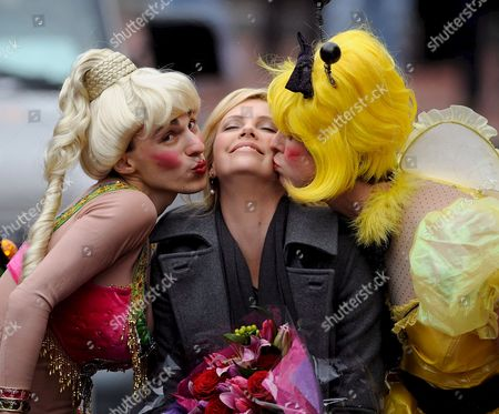 South African Actress Charlize Theron (c) is Kissed by David Anderson (l) and Evan Eachus (r) of the Haxty Pudding Theatricals During the Parade Portion of the Presentation of the 2008 Hasty Pudding Theatricals Woman of the Year at the New College Theatre On the Harvard University Campus in Cambridge Massachusetts Usa 7 February 2008 the Woman of the Year Award is Presented Annually to a Performer Who Has Made a 'Lasting and Impressive Contribution to the World of Entertainment ' and Theron Joins Other Past Honorees Including Meryl Streep Katharine Hepburn Julia Roberts Jodie Foster Meg Ryan Halle Berry and Most Recently Scarlett Johansson