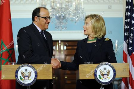 Us Secretary of State Hillary Clinton (r) Shakes Hands with Moroccan Foreign Minister Taieb Fassi Fihri (l) Following Their Bilateral Meeting at the State Department in Washington Dc Usa 23 March 2011 Secretary Clinton and Foreign Minister Fihri Discussed the Un Sanctioned No Fly Zone Over Libya the 23 March 2011 Bus Bomb in Jerusalem and the Situation in Japan United States Washington