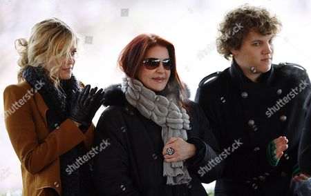 Ex-wife of Elvis Presley Priscilla Presley Center Stands Between Her Grandchildren Riley Keough Left and Benjamin Keough During the Celebration of what Would Have Been Entertainer Elvis Presley's 75th Birthday Near Graceland His Memphis Tennessee Usa Home 08 January 2010 the Keoughs Are Lisa Marie's Children Elvis Died at Age 42 in 1977 Thousands of Fans From Around the World Make Pilgrimages Each Year to Honor Their Hero United States Memphis