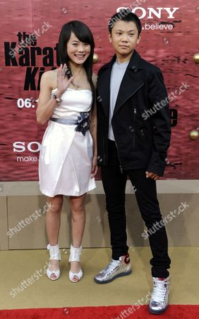 Chinese Actors Wenwen Han (l) and Zhenwei Wang (r) Arrive For the Premiere of 'The Karate Kid' at Mann Village Theatre in Los Angeles California 07 June 2010 the Movie Which is Set in China Opens 11 June in the United States United States Los Angeles