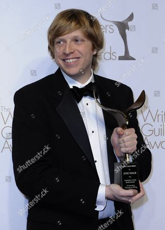 Stock Photo of Us Game Designer Jeffrey Yohalem Holds His Wga Award For Outstanding Videogame Writing For 'Assassin's Creed: Brotherhood' at the Writers Guild of America Awards (wga) in Hollywood California Usa 05 February 2011 United States Hollywood