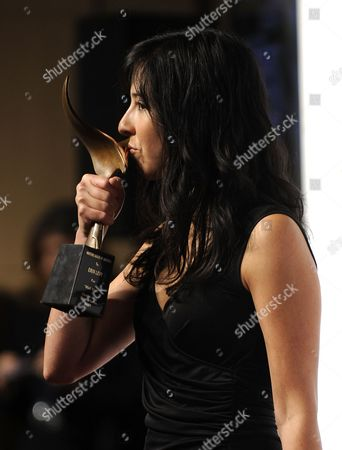 Stock Image of Us Screenwriter Erin Levy Kisses Her Awards For Outstanding Drama Series and Episodic Drama For 'Mad Men' at the Writers Guild of America Awards (wga) in Hollywood California Usa 05 February 2011 United States Hollywood