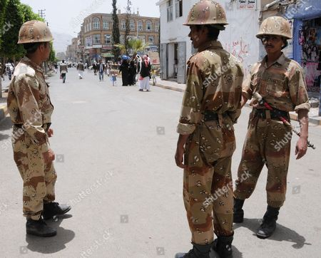 Yemeni Soldiers Stand Guard in a Street in Sana'a Yemen 07 May 2011 According to Media Sources the Attack on Yemen That Killed Two Al Qaeda Leaders Two Days Earlier was Carried out by a Us Military Drone Targetting the Radical Us-born Muslim Preacher Anwar Al-awlaki Yemen Sana'a