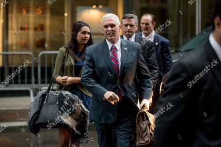 Mike Pence, Audrey Pence Vice President-elect Mike Pence, center, accompanied by his daughter Audrey, left, arrives at Trump Tower in New York