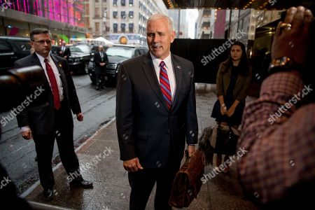 Stock Photo of Mike Pence, Audrey Pence Vice President-elect Mike Pence, accompanied by his daughter Audrey, right, speaks to the media as he arrives at Trump Tower in New York