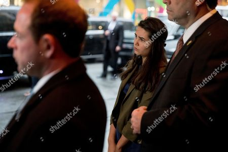 Stock Picture of Audrey Pence, second from right, listens as her father, Vice President-elect Mike Pence, speaks to the media as he arrives at Trump Tower in New York