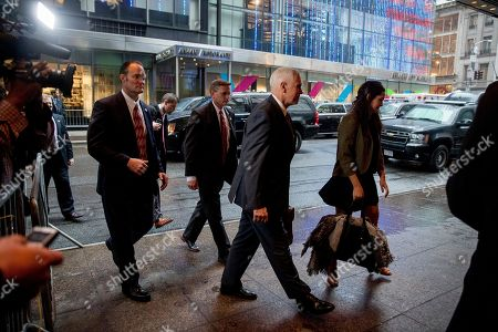 Stock Image of Mike Pence, Audrey Pence Vice President-elect Mike Pence, second from right, accompanied by his daughter Audrey, right, arrives at Trump Tower in New York