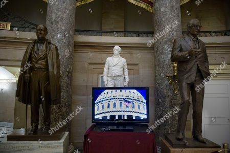 A video monitor sits in front of the statues of, from left, former Vice President Hannibal Hannibal of Maine, former Representative and Senator Daniel Webster and former Arizona Sen. Barry Goldwater in Statuary Hall on Capitol Hill in Washington, as the 115th Congress begins