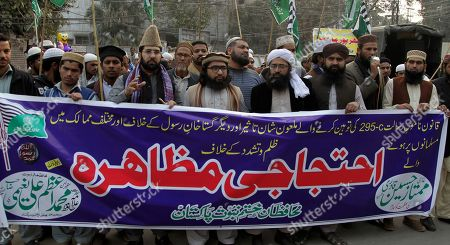 """Pakistani supporters of Mumtaz Hussain Qadri, who was hanged for killing the Punjab's governor Salman Taseer in 2011, rally in Lahore, Pakistan, . The son of a Pakistani politician killed for opposing the country's harsh blasphemy laws says he is now receiving death threats for supporting a Christian woman on death row for insulting Islam. Banner reads """"protest rally"""