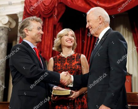 Joe Biden, Rand Paul, Kelley Paul Vice President Joe Biden shakes hands with Sen. Rand Paul, R-Ky., with his wife Kelley Paul, after administering the Senate oath of office during a mock swearing in ceremony in the Old Senate Chamber on Capitol Hill in Washington