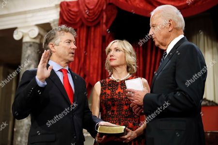 Joe Biden, Rand Paul, Kelley Paul Vice President Joe Biden administers the Senate oath of office to Sen. Rand Paul, R-Ky., with his wife Kelley Paul, holding a bible, during a mock swearing in ceremony in the Old Senate Chamber on Capitol Hill in Washington