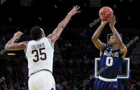 Nick Griffin, Bonzie Colson Saint Peter's Nick Griffin (0) shoots over Notre Dame's Bonzie Colson (35) during the second half of an NCAA college basketball game, in South Bend, Ind