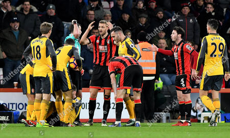 Stock Photo of Steve Cook, of Bournemouth, remonstrates with referee Micheal Oliver after being shown the red card, during the Premier League match between Bournemouth and Arsenal, at The Vitality Stadium (Dean Court) on 3rd January 2017.