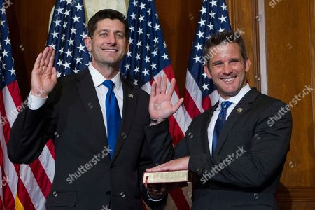 House Speaker Paul Ryan of Wis. administers the House oath of office to Rep. Adam Kinzinger, R-Ill., during a mock swearing in ceremony on Capitol Hill in Washington, as the 115th Congress began
