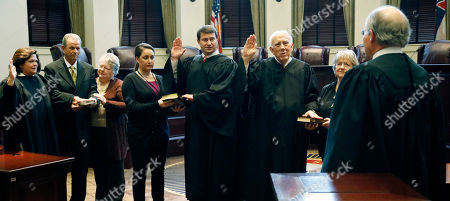 William Waller Jr., Dawn Beam, James Maxwell, Jim Kitchens Mississippi Supreme Court Chief Justice William Waller Jr., right, swears into office three returning justices for the nine-member Mississippi Supreme Court,at the Carroll Gartin Justice Building in Jackson, Miss. They are, from left, Justices Dawn Beam of Sumrall, left, James Maxwell of Oxford, center, and Jim Kitchens of Crystal Springs, third from right. One new justice, Bobby Chamberlin of Hernando, a former circuit judge who was elected to the state's highest court in November, was sworn in after the three returning justices took their oaths