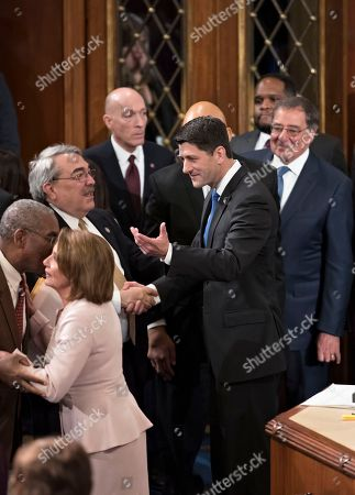 Paul Ryan, Nancy Pelosi, G. K. Butterfield, Leon Panetta House Speaker Paul Ryan of Wis., shakes hands with Rep. G. K. Butterfield, D-N.C., chairman of the Congressional Black Caucus, as he is escorted by House Minority Leader Nancy Pelosi of Calif., lower left, following his re-election as house speaker, on Capitol Hill in Washington, as the 115th Congress convened. At far right is former Defense Secretary and past CIA director Leon Panetta, whose son Jimmy Panetta was sworn in to the 115th Congress