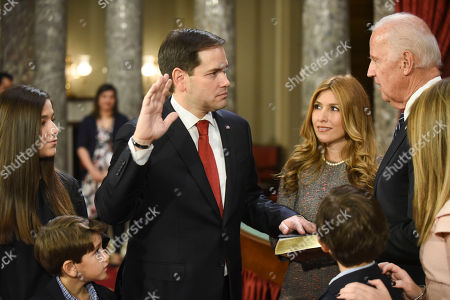 Jeanette Dousdebes Rubio, Marco Rubio, Joe Biden Vice President Joe Biden administers the Senate oath of office to Sen. Marco Rubio, R-Fla., as his wife, Jeanette Dousdebes Rubio, holds a Bible during a a mock swearing in ceremony in the Old Senate Chamber on Capitol Hill in Washington, as the 115th Congress begins