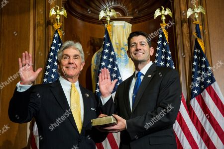 House Speaker Paul Ryan of Wis. administers the House oath of office to Rep. Roger Williams, R-Texas, during a mock swearing in ceremony on Capitol Hill in Washington, as the 115th Congress began