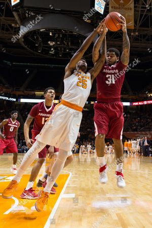 Stock Photo of Anton Beard #31 of the Arkansas Razorbacks grabs the rebound from Shembari Phillips #25 of the Tennessee Volunteers during the NCAA basketball game between the University of Tennessee Volunteers and the University of Arkansas Razorbacks at Thompson Boling Arena in Knoxville TN Tim Gangloff/CSM