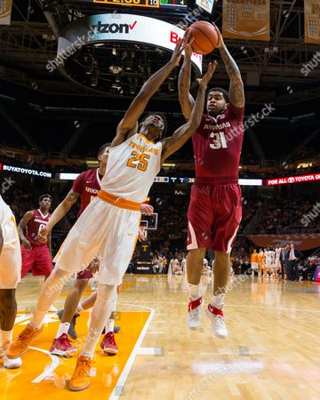Anton Beard #31 of the Arkansas Razorbacks grabs the rebound from Shembari Phillips #25 of the Tennessee Volunteers during the NCAA basketball game between the University of Tennessee Volunteers and the University of Arkansas Razorbacks at Thompson Boling Arena in Knoxville TN Tim Gangloff/CSM